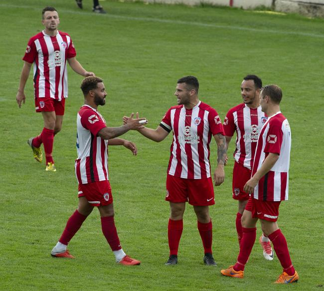 Bromsgrove's players celebrate Rich Gregory's goal against Worcester. Photo by Paul France