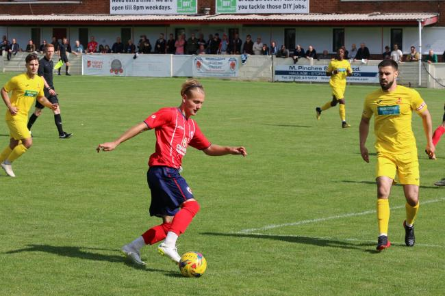 Charlie Dowd on the attack for Sporting. Photo by David Besley