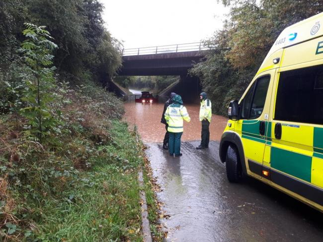 SCENE: A car has become stranded in flood water in Green Lane, Droitwich. Photo: @SWorcsCops
