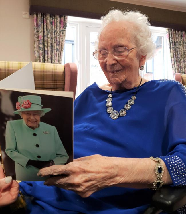 Beryl Pantall with her 100th birthday card from The Queen.