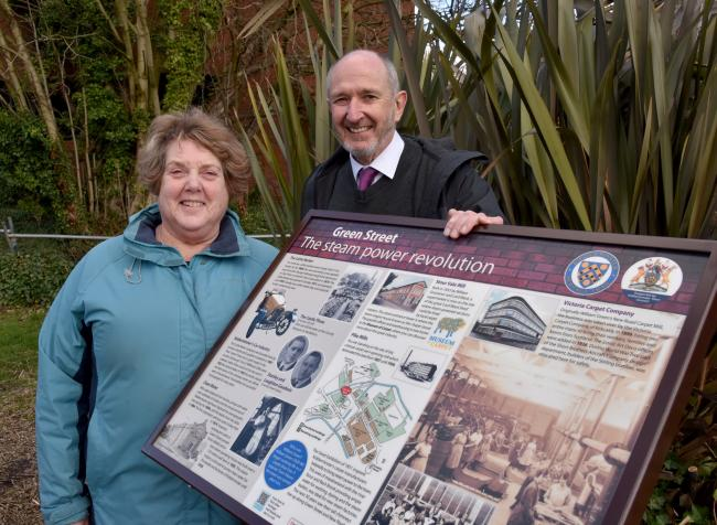 Project leader Dave Laverty and town councillor Rose Bishop with the new information board at Pike Mills in Green Street. Photo by Colin Hill