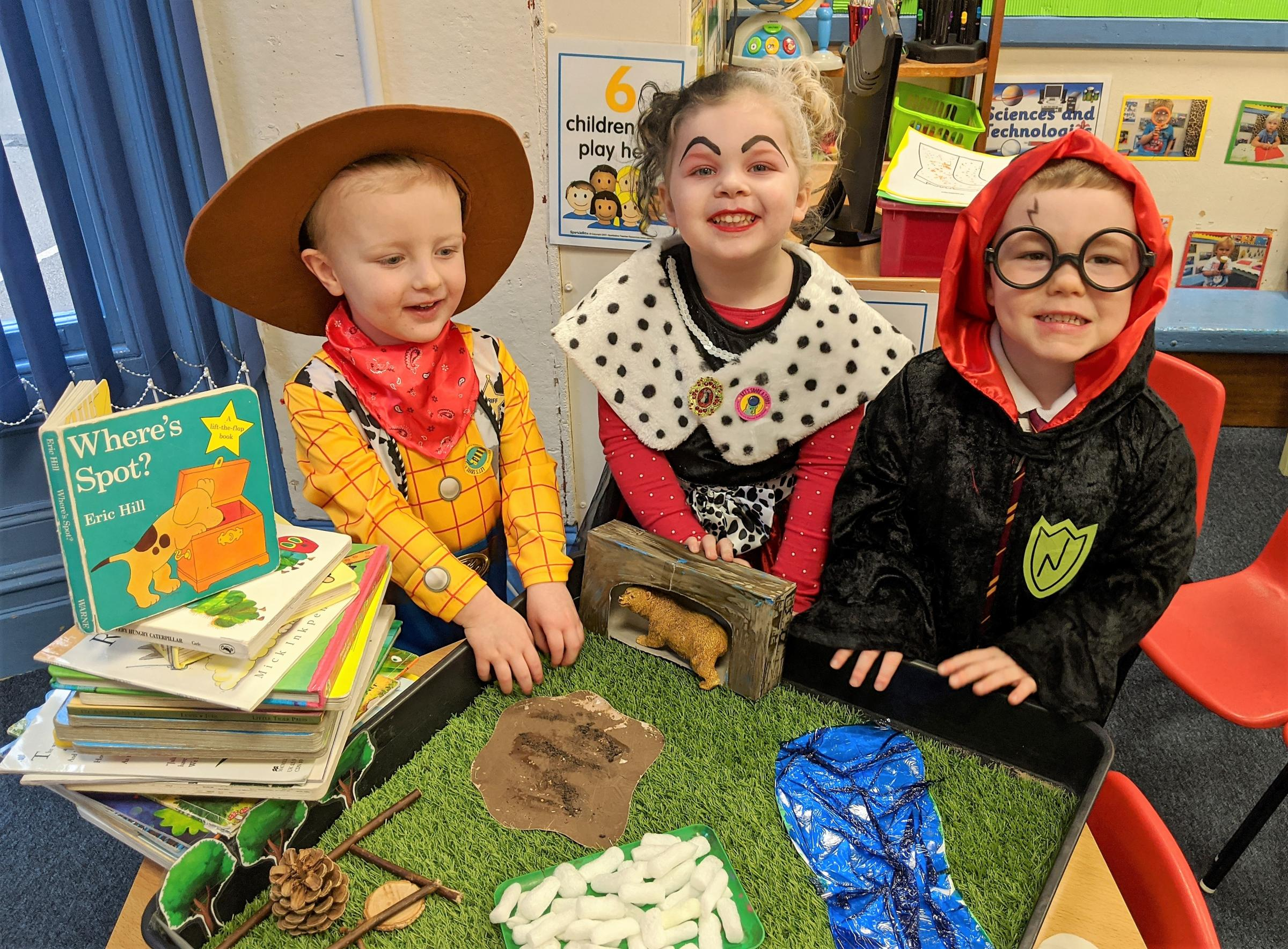 "Droitwich Advertiser: The children at Kidderminster's Little Trinity Nursery shared a wonderful week and dressed up as their favourite book character to celebrate World Book Day on Thursday 5th March.Nursery Manager, Gaynor Carter, said: ""Each class throughout the week focused on their favourite stories.""Yellow Bumble Bee room enjoyed 'Going on a Bear Hunt' and 'Dear Zoo' whilst our Red Ladybird room enjoyed reading 'The Enormous Turnip', 'Elmer' and 'Who am I asked the Butterfly?' with activities including going on a minibeast hunt, looking at the butterfly lifecycle and preparing a butterfly garden ready for the baby caterpillars when they finally arrive in a few weeks' time.""They also enjoyed story sacks and mirror play, looking at similarities and differences as well as taking part in role play activities using facemasks and using the 'Bear Hunt' tuff tray for small world play as well as enjoying a Superhero themed lunch. In a week-long celebration of books, ninety-four children took part with the highlight being children and staff dressing up as their favourite characters on World Book Day. Added Gaynor: ""We celebrate World Book Day every year because language, literacy and communication is such a vital part of a child's learning and story time is very often their favourite time of the day. ""Encouraging reading and enjoyment of books is part of our weekly activities, with our lending library offering the children a chance to choose a book that they can then take home and share with their families. World Book Day is a great excuse to simply have fun, share stories, enjoy a favourite book and dress up. What an amazing week!""Image details from L to R: Little Trinity Nursery children 3-year old Oliver Need, 4-year old Felicity Janes and 3-year old Harry Parsons having fun on World Book Day."