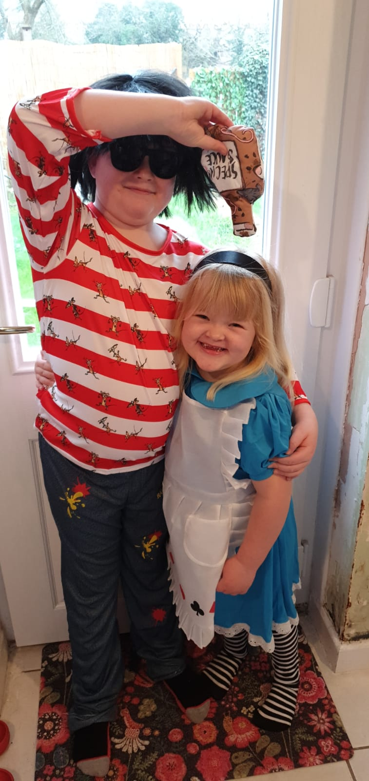 Droitwich Advertiser: Alice in wonderland aka Louisa Collins meets rat burger aka Riley Collins for world book day.