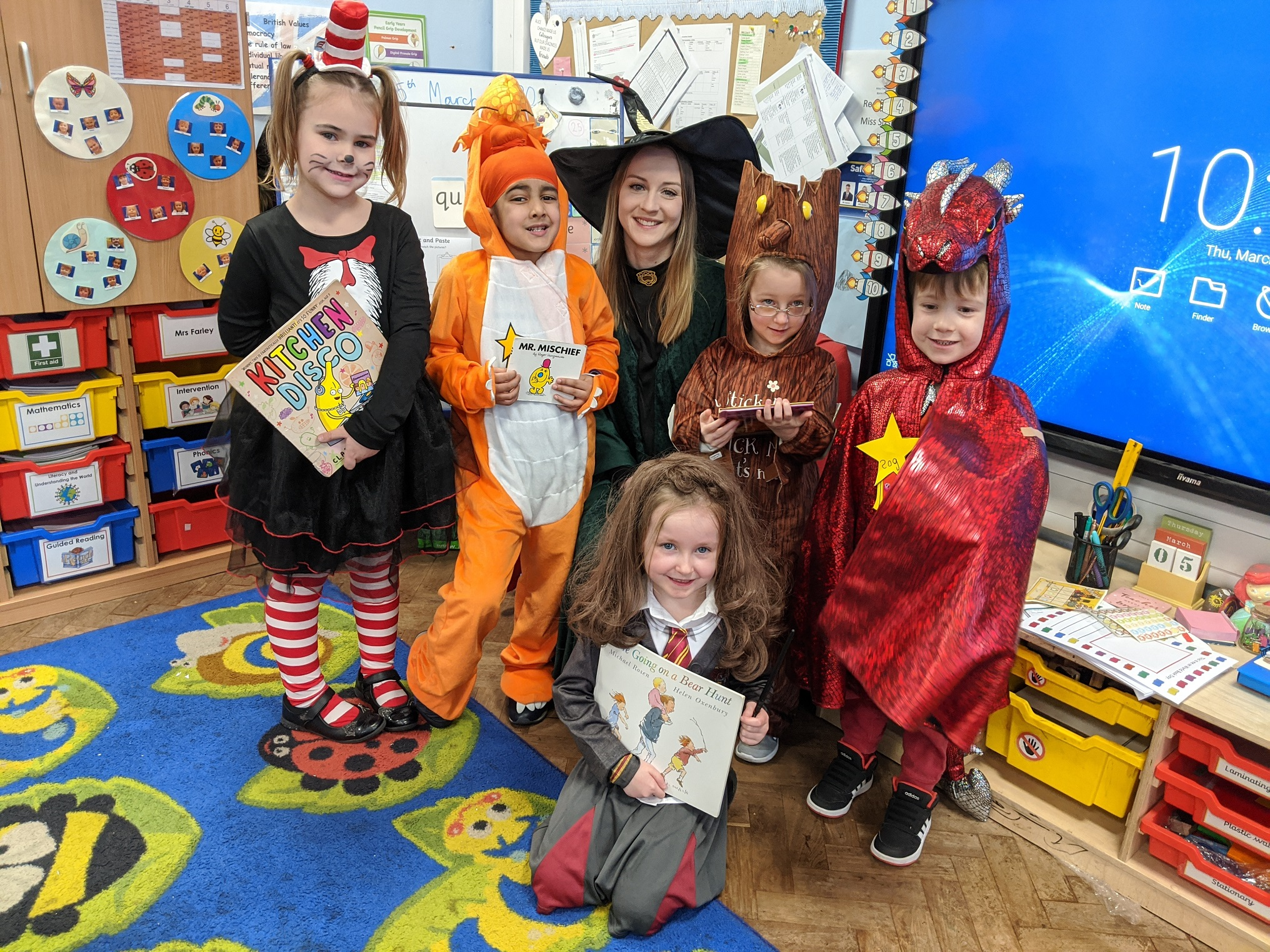 "Droitwich Advertiser: Pupils at Kidderminster's Holy Trinity School and Sixth Form Centre in celebration of World Book Day (WBD), Thursday 5th March, dressed up as their favourite 'Story Heroes' and held a 'Preloved Book Swap' for the school's younger children who each selected a book of their choice to take home for free.This year's celebrations began with the WBD 'Share a Story' campaign which runs from Thursday 27th February all the way through to Sunday 29th March, with all pupils receiving a £1 World Book Day voucher to be exchanged for one of twelve specially published texts available from major supermarkets and bookshops or used at the school's Book Fair at the end of the month.Associate Head for Phase 1 Reading and Phonics, Katherine Slack, said: ""Each year we try to vary how we celebrate World Book Day and this year our theme is 'Story Heroes' with all pupils from Reception to Year 8 and staff encouraged to dress up as a hero or heroine from a book, comic or graphic novel. Older pupils have been asked to select a quote spoken by their chosen hero, which will be displayed in school. This year the school has also registered to take part in World Book Day 'Share a Story' campaign which aims to share a MILLION stories during World Book Day month.""The day also included creative comic strip and superhero bookmark competitions and a World Book Day Superhero themed lunch of Marvel pork meatballs and Spiderman spaghetti, Superman vegetable burgers with Incredible potatoes, Green Lantern peas, Captain America carrots and Super Power chocolate cake. Local artist and cartoonist, Geoff Tristram, delivered entertaining and instructive workshops to aspiring illustrators and a school governor shared why there is nothing better to read than children's literature.  Added Miss Slack: ""Sharing stories in school and at home should be as non-negotiable as feeding your child. Even if your child is struggling to develop their reading skills, nurture their love of stories and your child will be motivated to persevere."""
