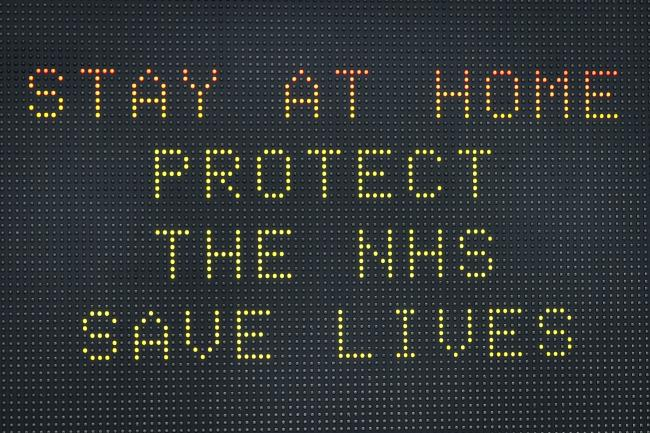 SIGN: A sign for people to stay at home to protect the NHS and save lives. Picture: Ben Birchall/PA Wire