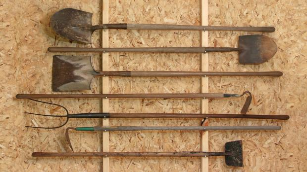 Droitwich Advertiser: Get heavy tools, rakes, shovels, etc., off the floor using utility hooks or, even, nails. Credit: Getty Images / Twoellis