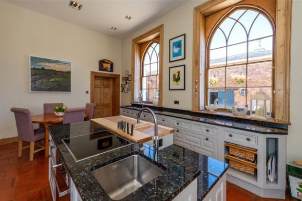 Droitwich Advertiser: A kitchen in the 10 bedroom property (Photo: Zoopla)