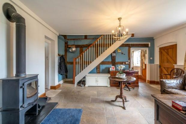 Droitwich Advertiser: The living room in the farmhouse (Photo: Zoopla)
