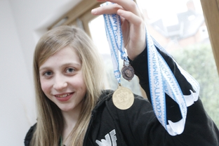 Golden joy: Olivia Gardner won gold at Worcestershire County Swimming Championships.
