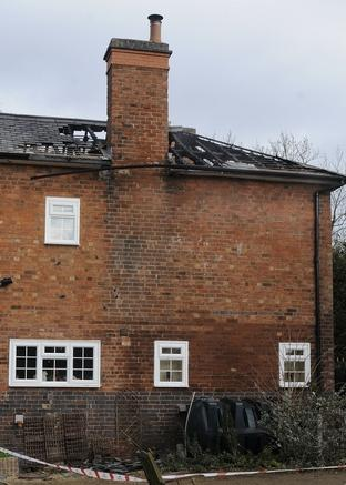The fire damaged roof at a house in Hanbury Road
