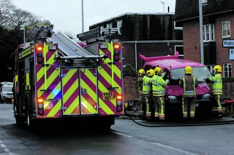 New Road incident: Firefighters use cutting equipment to free a man trapped in a Toyota people carrier. Ref:s
