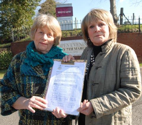 Frustrated: Jan Adams and Anne Cox with the petition outside the Mercure Kidderminster hotel. Buy this photo 111225M at kidderminstershuttle.co.uk/pictures or by calling 01562 633333.