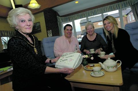 Caroline Spencer, civic head of Bromsgrove District Council, John Sanders, participation manager of Age UK Bromsgrove & District, new group user Gillian Siani, and Alison Schofield, chief officer for Age UK Bromsgrove & District. Buy this photo RMM121201a