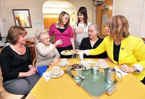 WELL DONE EVERYBODY: MP Harriett Baldwin chats to manager Jackie Creese, resident Phyllis Bladder, support assistants Sophie Fereday and Anna Petlanova and resident Tom Bowen. Picture by John Anyon. BUY: worcesternews.co.uk/pictures/sales. 1048