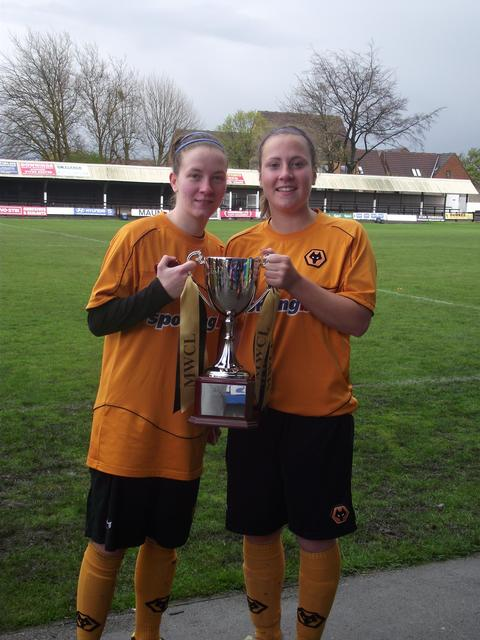 Success: Lauren Whiteman (right) with the trophy.