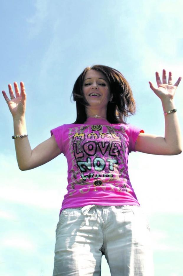 Mandy Able prepares for her charity skydive.