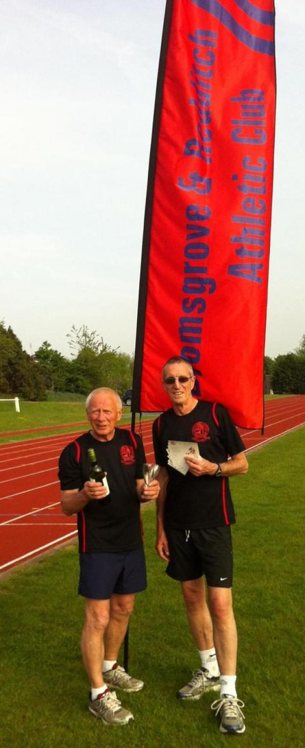 Droitwich Advertiser: Golden anniversary: Club chairman Len Quartly (ight) and president Roger Beacham (left) wearing the club's 50th anniversary commemorative shirts, tickets and celebratory drinks.