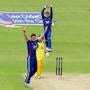 England's Steven Finn (front) celebrates the wicket of Australia's David Warner at Chester-le-Street