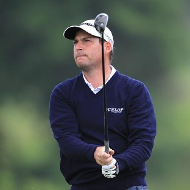 David Howell fired a four-under 67 to grab a share of the lead at the French Open