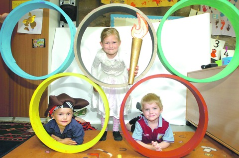 Jaygo Morris, Millicent Harding and Freddie Dale help raise funds for St Peter's Pre-School with an Olympics day.