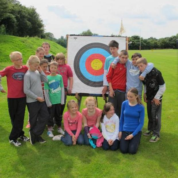Young people enjoy an archery lesson with the Festival gets2gether club.