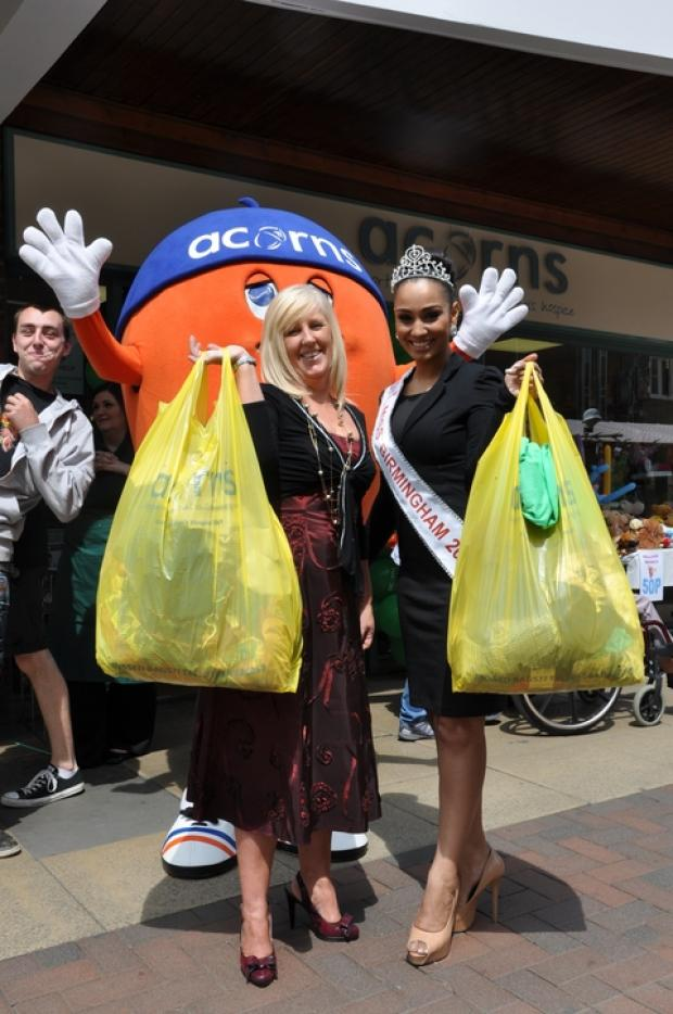 Acorns' head of retail Janice McPherson and Acorns' supporter Miss Birmingham, Kris'ina Jagpal, appeal for stock over the school holidays.