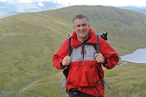 Mike Russell prepares for his charity trek.