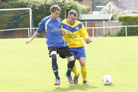 Battle: Action from Fairfield Villa's match with Greenhill. Picture: CRAIG ROSS
