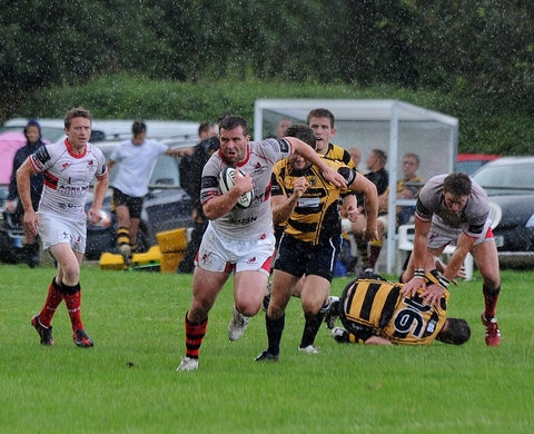 Coming through: Dave Hughes strides forward for Bromsgrove. Picture: PETE JEPSON