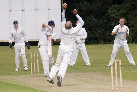 Howzat! A Knowle player takes a catch on Saturday. Picture: MARTIN HUMBY