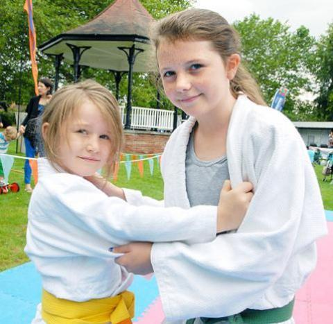 Droitwich Advertiser: Harriet Ruchelle, left, aged seven, and Jade Moseley, 11, from Droitwich Spa Judo Kan, demonstrate technique.