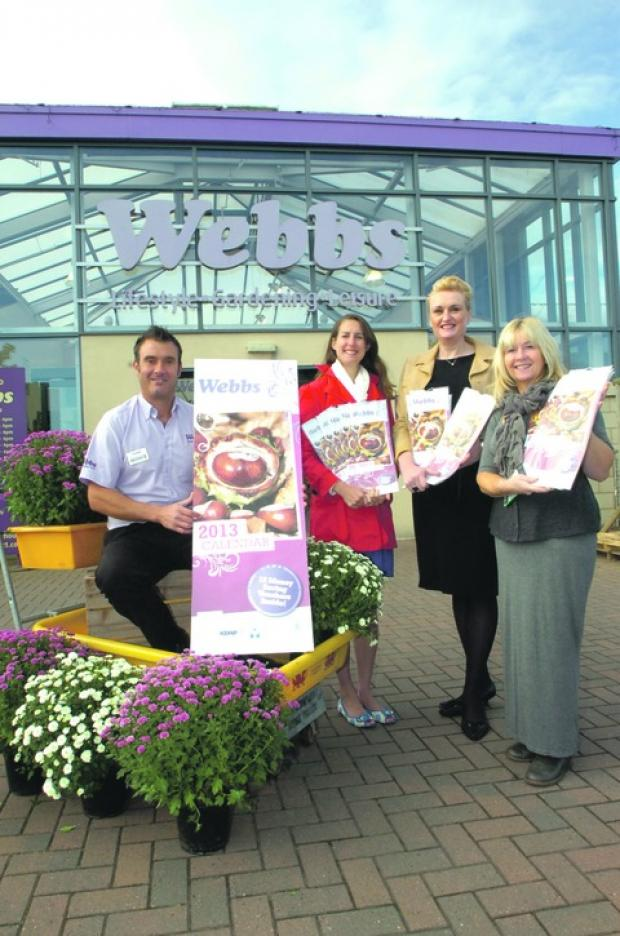 Droitwich Advertiser: Jason Osbourne, Webb's product category manager, Alison Parkes, from St Richards Hospice, Mandie Fitzgerald, from Acorns, and Wendy Stokes from the Primrose Hospice at the launch of the calendar.  Buy this photo BMM391202a