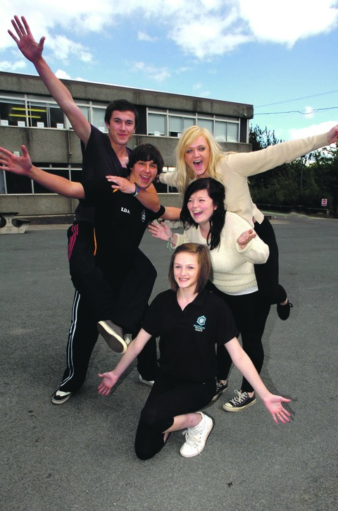 Frantic fun: Droitwich Spa High School pupils, including Sam Stedman, 17, Liam Alexandra, 17, Catrin Thomas, 14, Demi Hartley, 16, and Amber Cox, 16, worked with members of a professional theatre company.  Buy this photo BMM401201a