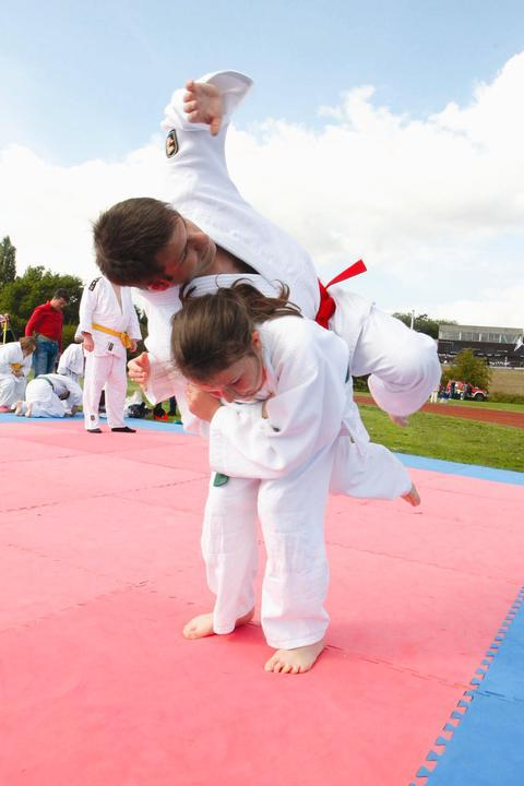 Jade Moseley, 11, and Chris Turner demonstrate Judo to visitors.
