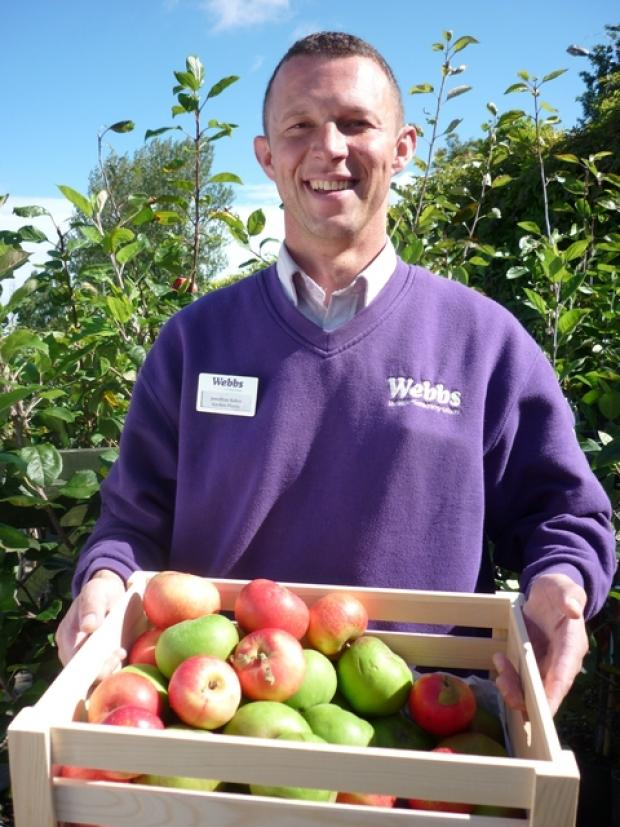 Droitwich Advertiser: Jonathon Baker from Webbs, Wychbold, gets his teeth into some tasty apples.