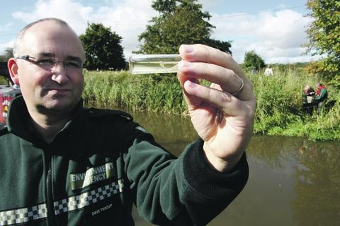 Dave Throup, from the Environment Agency, with a specimen collected in Tibberton.
