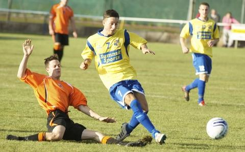 Danny Deehan tries to tackle a Southam player.