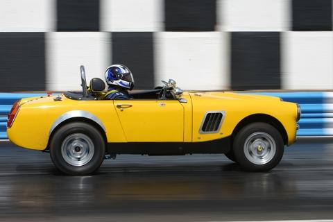 Yellow peril: Steve Cowling in his MG Midget.