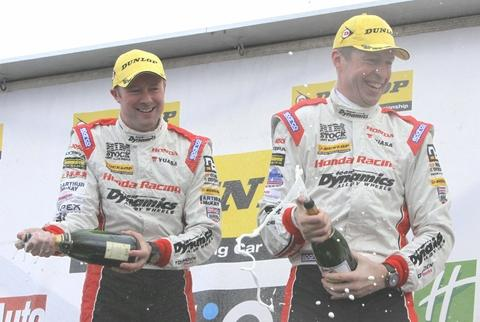 Champagne moment: Matt Neal (right) with Gordon Shedden.