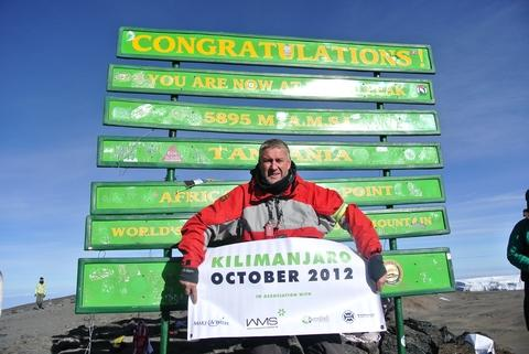 Mike Russell at the summit of Mount Kilimanjaro.