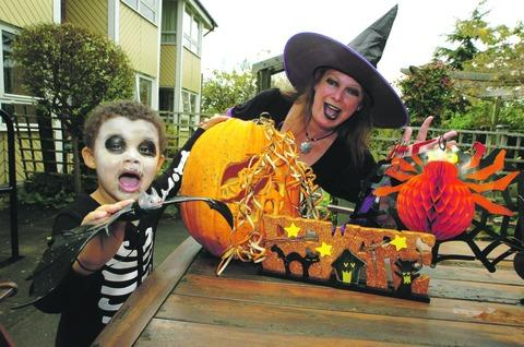 Jayden Farr, four, and Taymar Phillips, a member of staff from Westmead Care Home, prepare for Halloween celebrations.