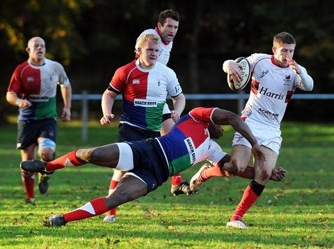 On the run: Bromsgrove's James Curgenven attempts to skip a Hull Ionians tackler. Picture: PETE JEPSON