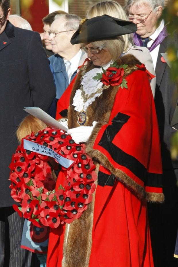 Droitwich Advertiser: Mayor of Droitwich, Councillor Anne Taft, prepares to lay a wreath.