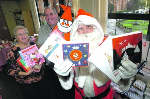 Jill and Paul Wheeler with Santa at the Droitwich Cards for Good Causes stall.