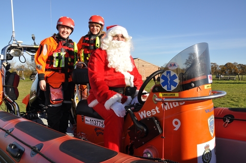 Breaking with tradition: West Midlands Search and Rescue team members Natasha Wheeler and Kylie Jackson with Father Christmas, who will be visiti