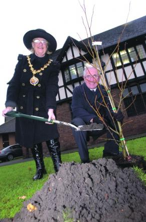 Mayor of Droitwich, Councillor Anne Taft, plants a tree with Civic Society chairman Stuart Haywood.