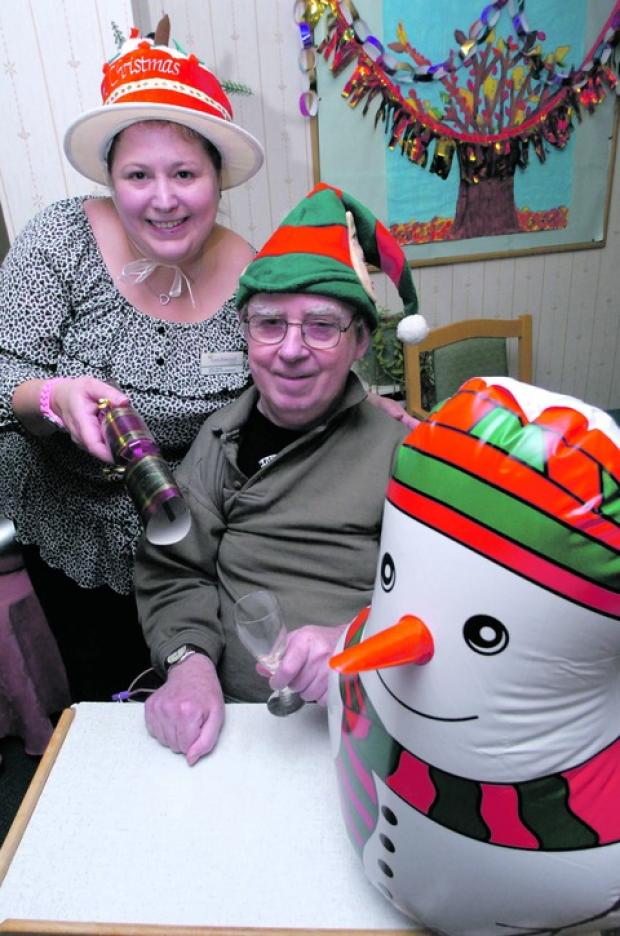 Activities co-ordinator Vikki Guest and resident Peter Green enjoy the Christmas party