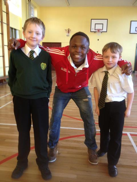 All smiles: Daniel Caine poses with Catshill students Charlie Quinney (right) and Harry Arnold.