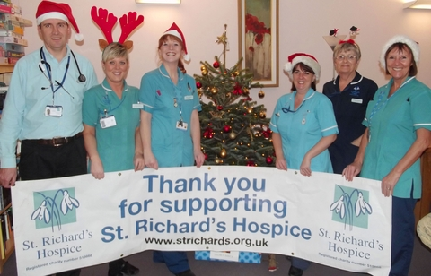 Hospice staff James Kerton, Lisa Laurie, Kelly Hinton, Shelly Lewis, Margaret Parkes and Sheila Keeble-Searle with one of the donated Christmas trees.