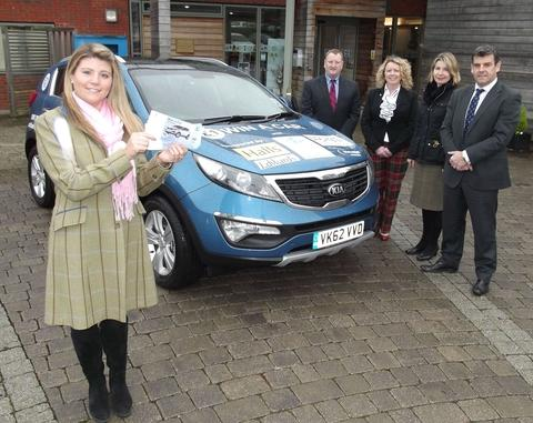Lizzie Brazier of St Richard's ready for the car raffle with Adrian  Edwards of Edwards Motors  , Kathy Leather of the Bank House Hotel; Jenny Cheshire, Worcester Racecourse and Richard Tomlinson, Halls Estate Agents.